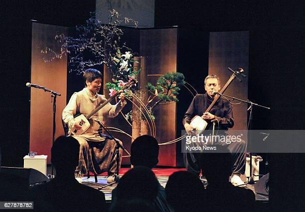 GENEVA Switzerland Shunsuke Kimura and Etsuro Ono play the Tsugaru shamisen stringed instrument in Neuchatel Switzerland during a ceremony to...