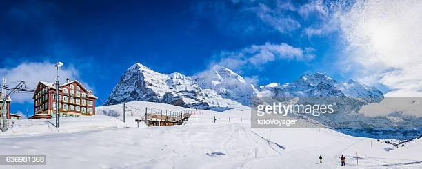 Switzerland skiers enjoying snow Kleine Scheidegg winter ski resort Alps