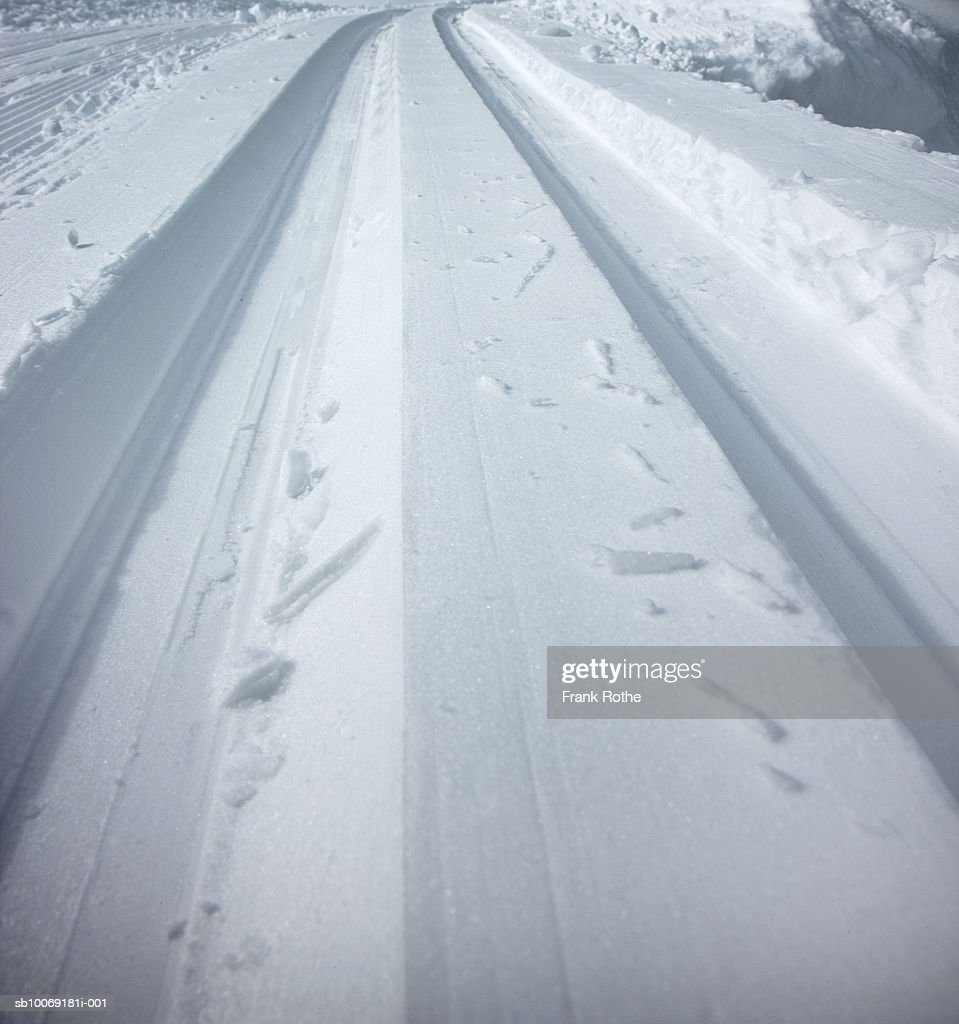 Switzerland, Snow covered country road : Stockfoto