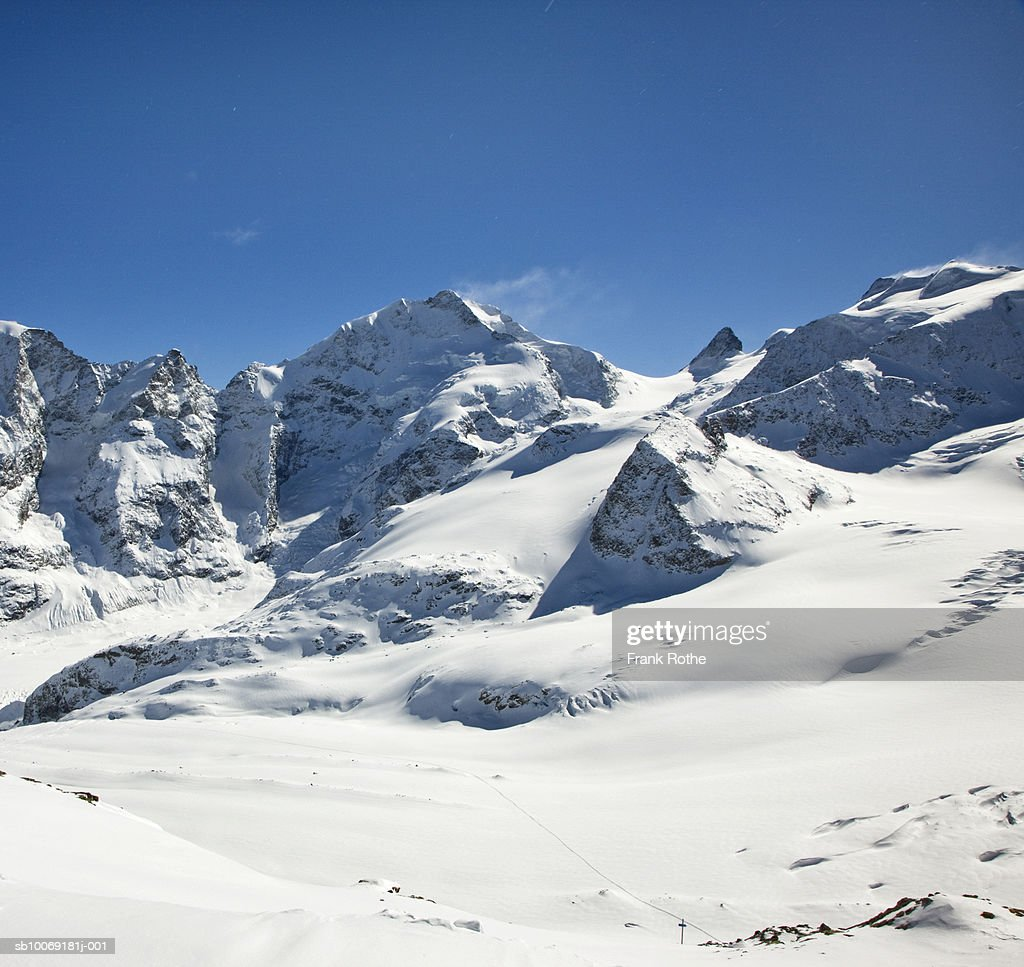 Switzerland, Snow covered mountains : Stockfoto