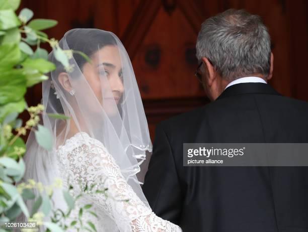 The bride Deniz Kaya comes with her father Metin to her wedding ceremony with Constantine of Bavaria Photo Franziska Kraufmann/dpa