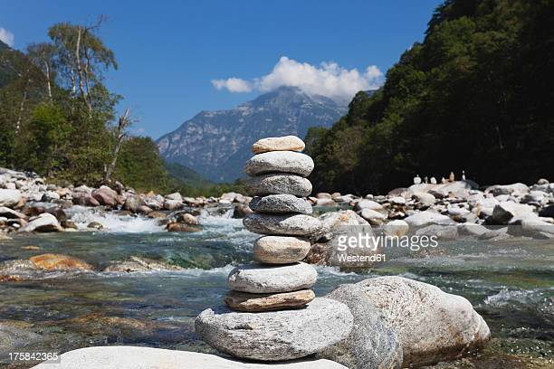 Switzerland, Stack of stone at Verzasca River