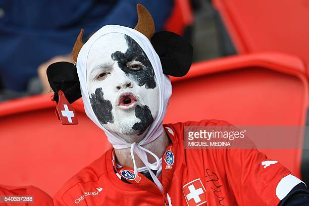 A Switzerland supporter reacts ahead the Euro 2016 group A football match between Romania and Switzerland at the Parc des Princes stadium in Paris on...
