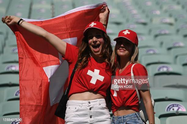 Switzerland supporters wage the national flag ahead of the UEFA EURO 2020 Group A football match between Wales and Switzerland at the Olympic Stadium...
