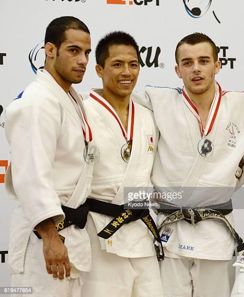 Switzerland - Three-time Olympic judo champion Tadahiro Nomura of Japan stands on the podium after winning the men's judo 60-kilogram category at the...