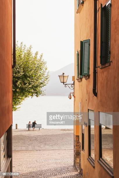 switzerland, ticino, lago maggiore, ascona, people relaxing at lakeside promenade - ascona stock photos and pictures