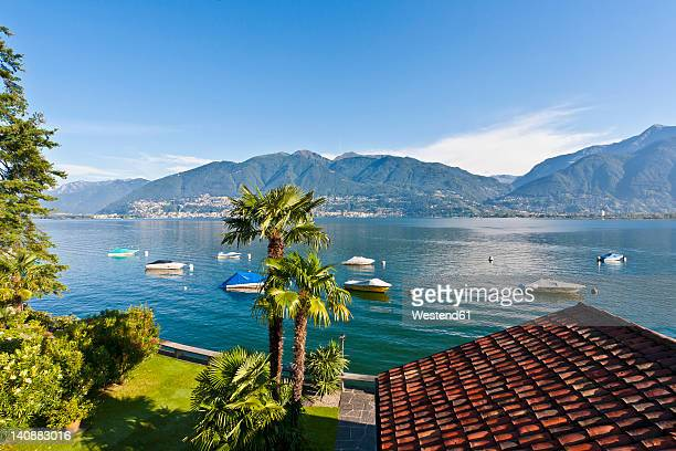 Switzerland, Ticino, View of roof with boats in Lake Maggiore