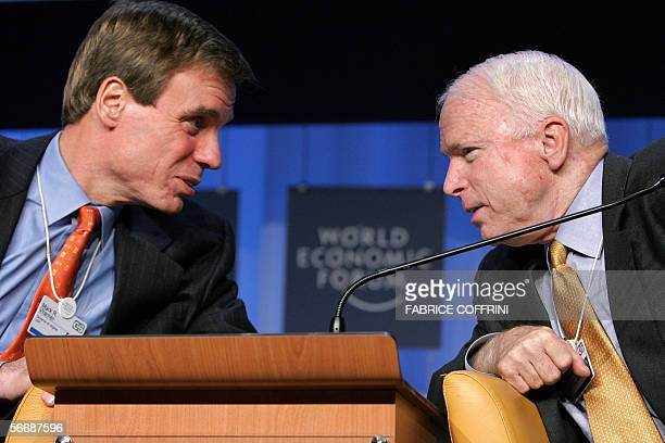 US Senator from Arizona John MacCain talks with his counterpart from Virginia Mark RWarner during the session the 'Future of the US Leadership' at...