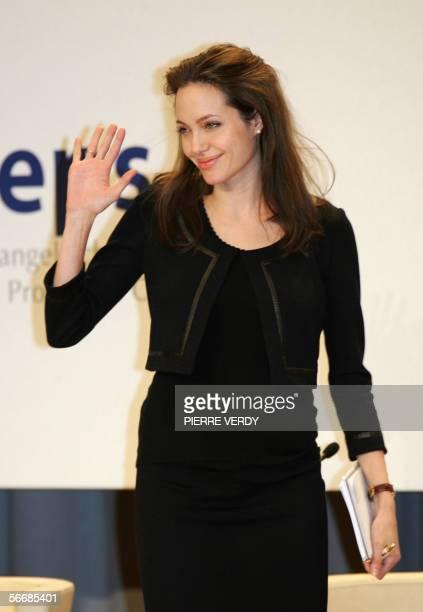US star and UN Refugee Ambassador for the United Nations High Commission for Refugees Angelina Jolie waves at the end of the session of the Open...