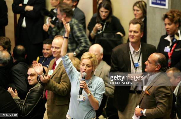 US star Sharon Stone waves as she raises the stakes for a good cause friday collecting 1000000 USD from the WEF participants at the World Economic...