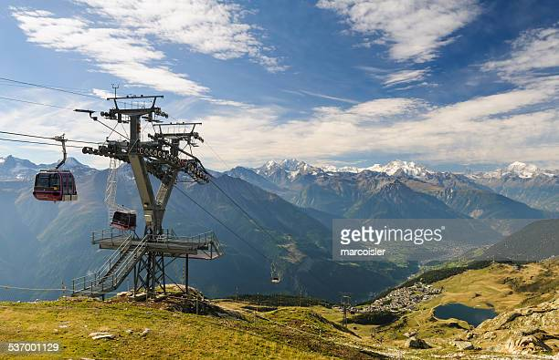 Switzerland, Valais, Betten, Bettmergrat, Overhead cable car passing by tower in mountains