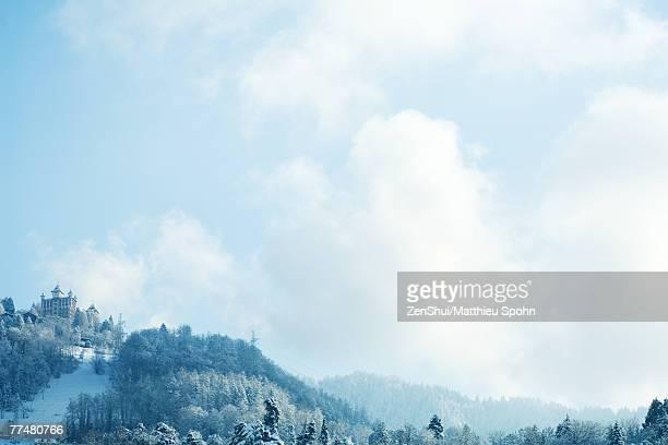 Switzerland, Vaud canton, Lavaux region, snowy mountain landscape with castle