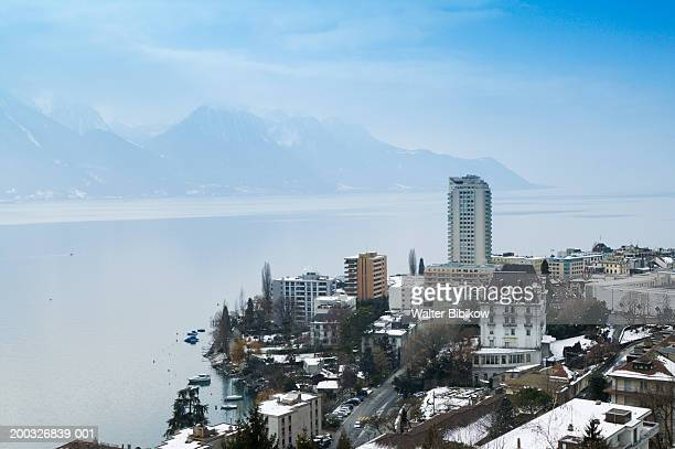 switzerland, vaud, montreux skyline and lake geneva, winter - montreux stock pictures, royalty-free photos & images