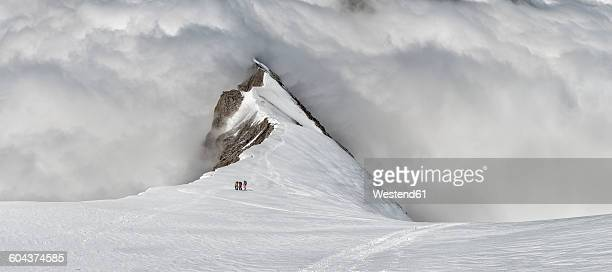 Switzerland, Western Bernese Alps, mountaineers in Balmhorn region