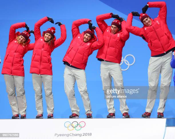 Switzerland wins gold at the mixed team alpine skiing finals in Pyeongchang South Korea 24 February 2018 Ramon Zenhaeusern Wendy Holdener Daniel Yule...