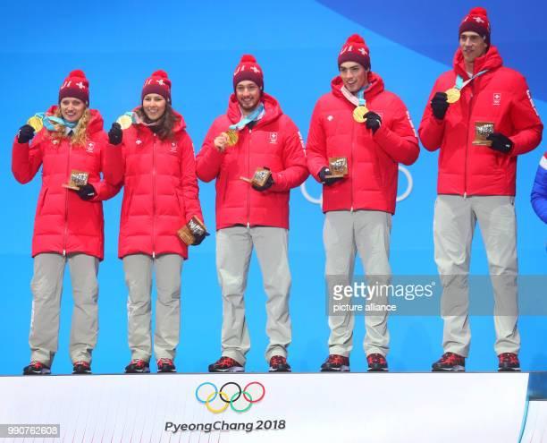 Switzerland wins gold at the mixed team alpine skiing finals in Pyeongchang South Korea 24 February 2018 Ramon Zenhaeusern Wendy Holdener Daniel Yule...