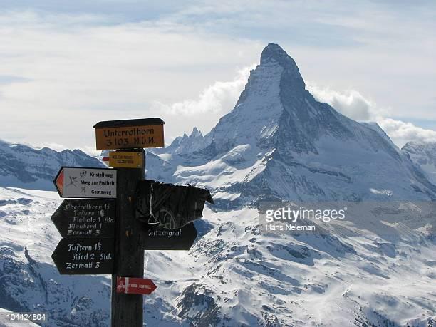 Switzerland, Zermatt, Cose up of wooden signposts with Matterhorn on background
