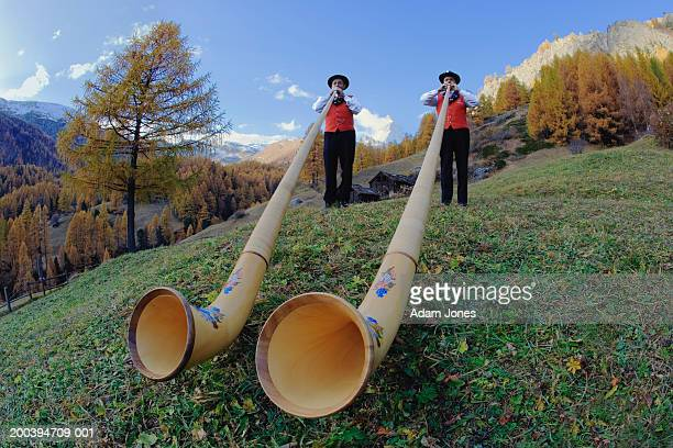 switzerland, zermatt, two alphorn players near matterhorn - switzerland stock pictures, royalty-free photos & images