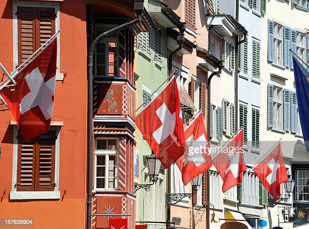 switzerland zurich city with flags on building facade - switzerland stock pictures, royalty-free photos & images