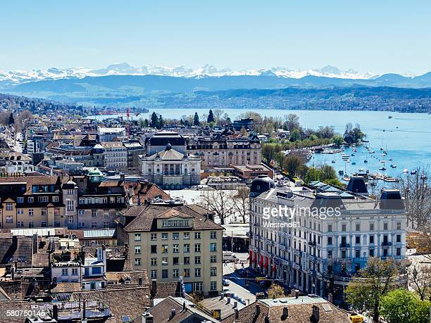 Switzerland, Zurich, Cityscape with Opera house, Lake Zurich, Alps in the background
