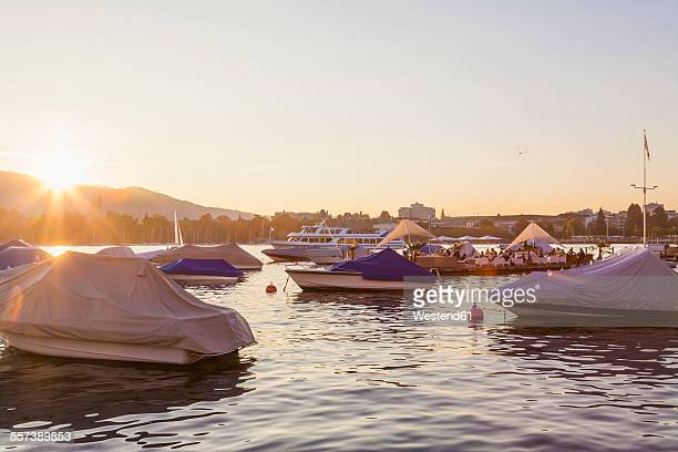 Switzerland, Zurich, Lake Zurich, Seefeldquai, Lounge on jetty at sunset