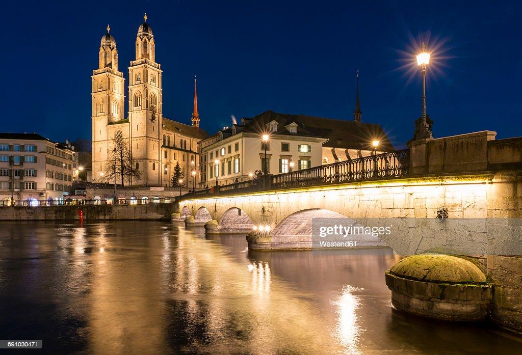 Switzerland, Zurich, view to Great Minster and Muenster Bridge at night : Stock Photo