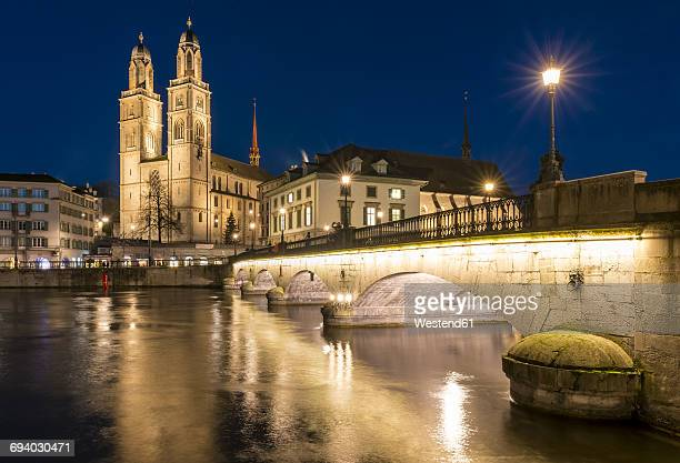 switzerland, zurich, view to great minster and muenster bridge at night - minster stock photos and pictures