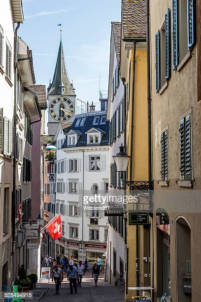 switzerland, zurich, view to pfalzgasse with st peter's church in the background - zurich stock pictures, royalty-free photos & images