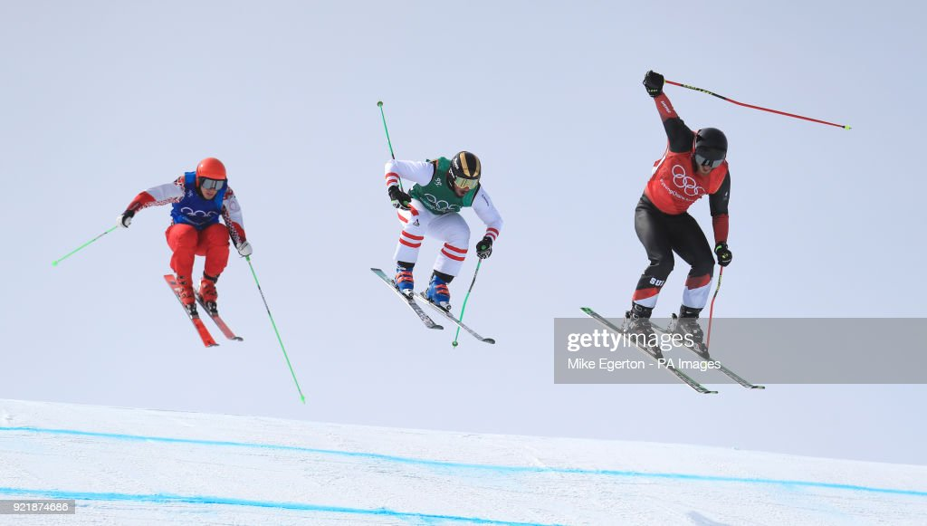 Switzerland's Alex Fiva (right) leads over the last jump to win his heat in the Men's Ski Cross at the Phoenix Snow Park during day twelve of the PyeongChang 2018 Winter Olympic Games in South Korea.
