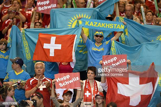 Switzerland's and Kazakhstan's supporters cheer during the Davis Cup World Group quarterfinal tennis Switzerland vs Kazakhstan on April 6 2014 in...