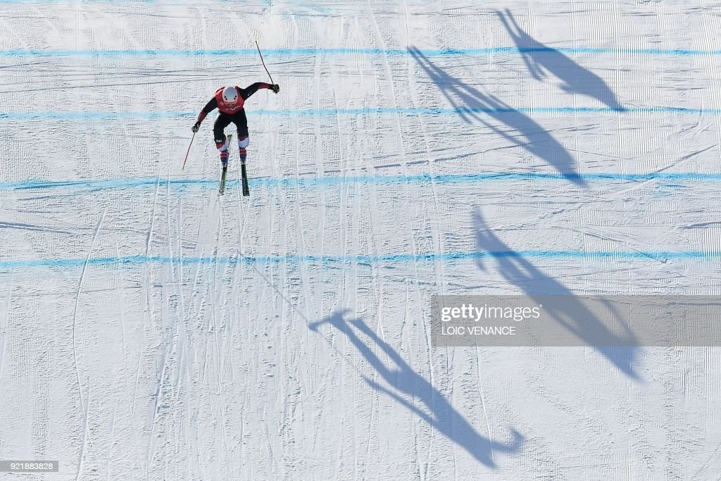 TOPSHOT - Switzerland's Armin Niederer competes to win the men's ski cross small final during the Pyeongchang 2018 Winter Olympic Games at the Phoenix Park in Pyeongchang on February 21, 2018. /