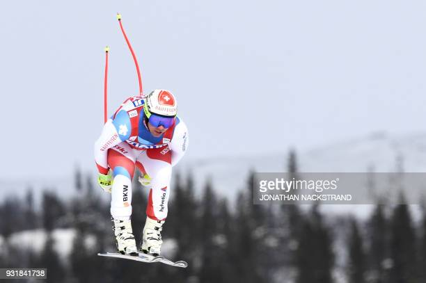Switzerland's Beat Feuz competes in the Men's Downhill of the FIS World Cup final event in Aare Sweden on March 14 2018 / AFP PHOTO / Jonathan...