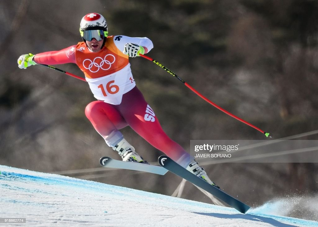 Switzerland's Beat Feuz competes in the Men's Super G at the Jeongseon Alpine Center during the Pyeongchang 2018 Winter Olympic Games in Pyeongchang on February 16, 2018. / AFP PHOTO / Javier SORIANO