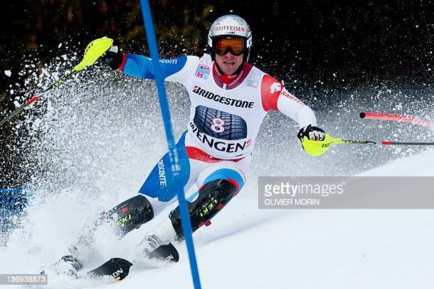 Switzerland's Beat Feuz competes on the way to the 2nd place during the FIS World Cup Men's Slalom of Super Combined on January 13 in Wengen AFP...