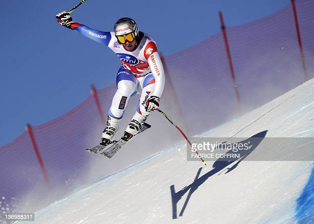 Switzerland's Beat Feuz jumps during the Men's downhill race of the FIS Alpine Skiing World Cup in Wengen on January 14 2012 Beat Feuz won the race...