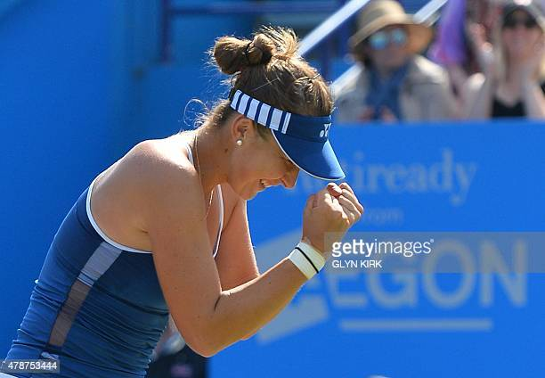 Switzerland's Belinda Bencic celebrates after beating Poland's Agnieszka Radwanska in the women's final match at the WTA Eastbourne International...