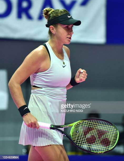Switzerland's Belinda Bencic reacts after a point against Spain's Garbine Muguruza during their women's singles first round match at the Pan Pacific...