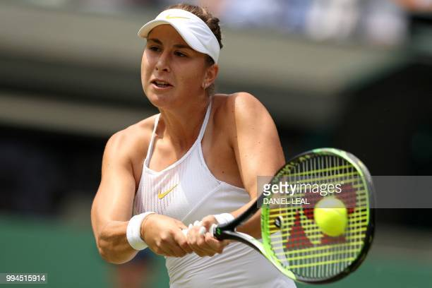 Switzerland's Belinda Bencic returns against Germany's Angelique Kerber during their women's singles fourth round match on the seventh day of the...