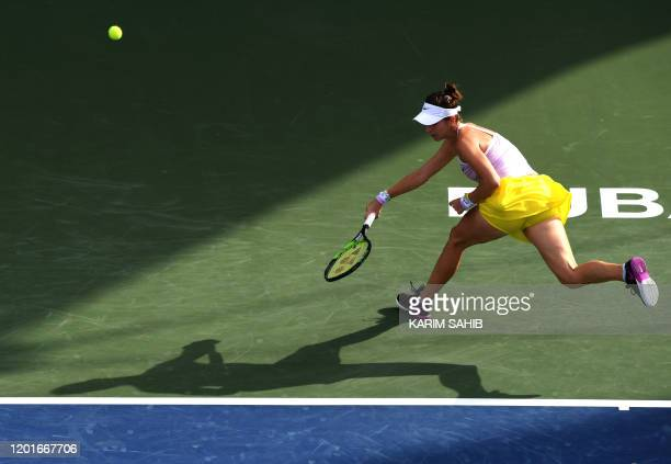 TOPSHOT Switzerland's Belinda Bencic returns the ball to Russia's Anastasia Pavlyuchenkova during the WTA Dubai Duty Free Tennis Championship at the...