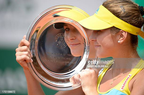 Switzerland's Belinda Bendic holds her trophy after winning the 2013 French tennis Open Girl's singles final against Germany's Antonia Lottner at the...