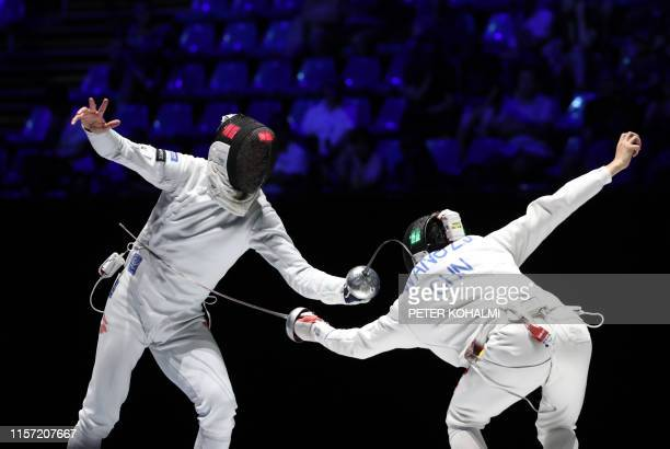 Switzerland's Benjamin Steffen and China's Wang Zijie compete in the Men's Epee team event for the third place at the 2019 Fencing World...