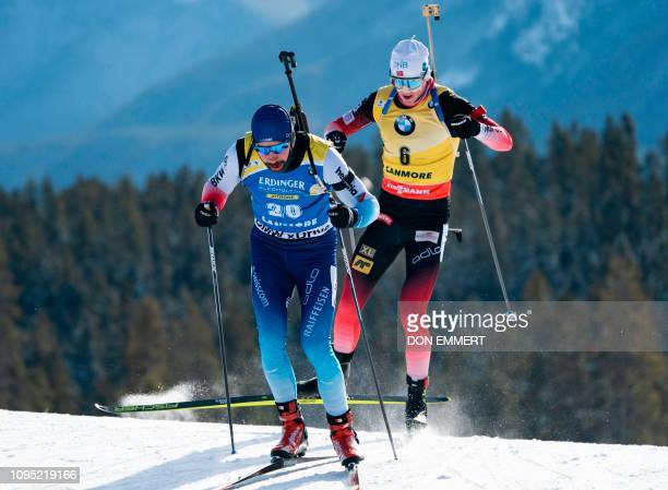 Switzerland's Benjamin Weger and Norway's Johannes Thingnes Boe compete in the shortened individual men's race during the IBU World Cup Biathlon in...