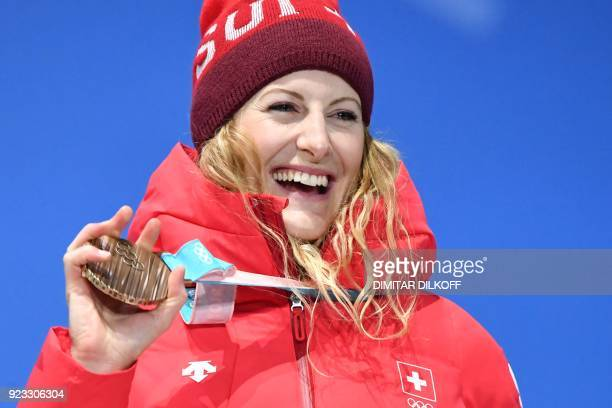 Switzerland's bronze medallist Fanny Smith poses on the podium during the medal ceremony for the freestyle skiing Women's Ski Cross at the...