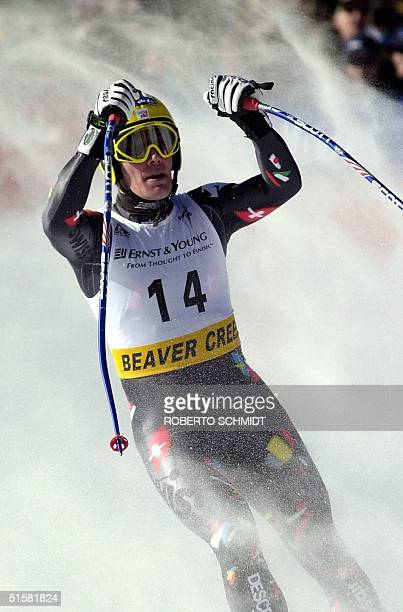Switzerland's Bruno Kernen raises his arms after finishing sixth in the men's World Cup Downhill 02 December 2000 at Beaver Creek Colorado Kernan...