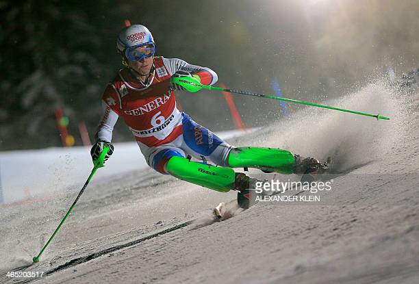 Switzerland's Carlo Janka competes during the FIS men's Alpine ski World Cup Super Combined Slalom race in Kitzbuehel on January 26 2014 France's...