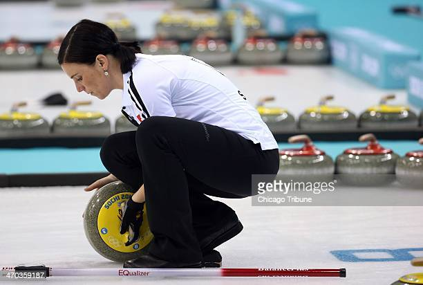 Switzerland's Carmen Kueng prepares a rock for a throw during women's curling semifinals at the Ice Cube Curling Center during the Winter Olympics in...