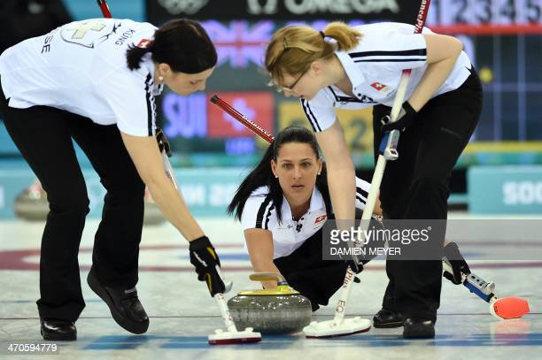 Switzerland's Carmen Schafer throws the stone during the Women's Curling Bronze Medal Game between Great Britain and Switzerland at the Ice Cube...