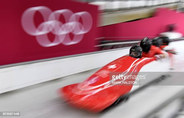Switzerland's Clemens Bracher leads his team in the 4man bobsleigh heat 2 run during the Pyeongchang 2018 Winter Olympic Games at the Olympic Sliding...