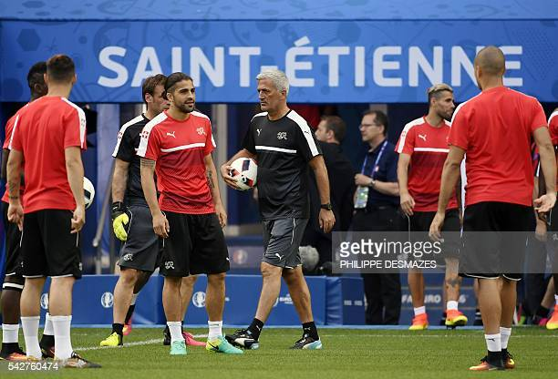 Switzerland's coach Vladimir Petkovic and his players a training session at the Geoffroy Guichard stadium in SaintEtienne France on June 24 2016 on...