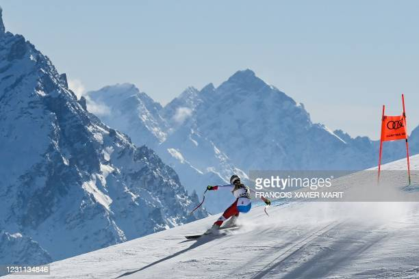 Switzerland's Corinne Suter competes during the Women's Downhill on February 13, 2021 during the FIS Alpine World Ski Championships in Cortina...